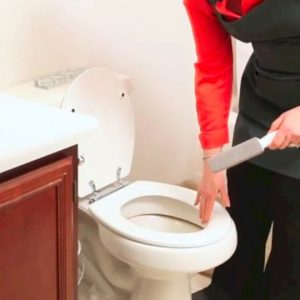 Woman cleaning the bathroom after remodel