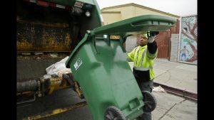 Picture of man dumping garbage